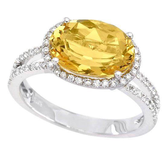 Кольцо с камнем берилл и бриллиантами фото