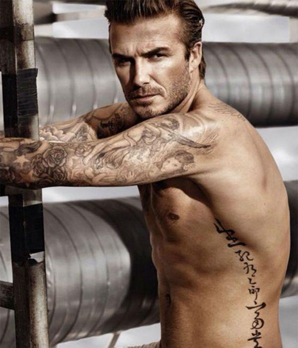 Мужская татуировка на подкаченном теле фото