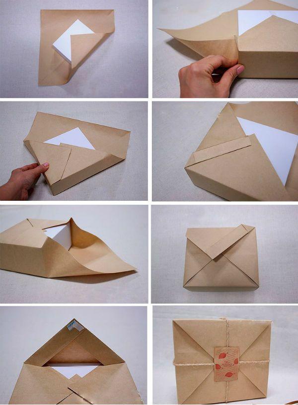 Упаковка подарка в крафтовую бумагу фото