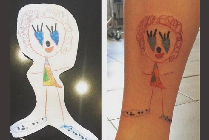 тату с рисунком ребенка на ноге фото