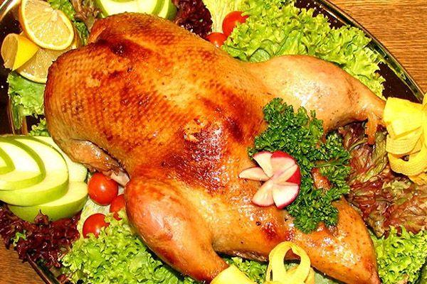 Утка, фаршированная куриными желудками и гречневой кашей фото